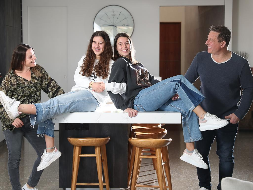 Jim and Tas Vassos with their teen daughters Nikola, 19, and Kristen, 16, are very liberal in allowing their girls to have some freedom. Picture: Alex Coppel.