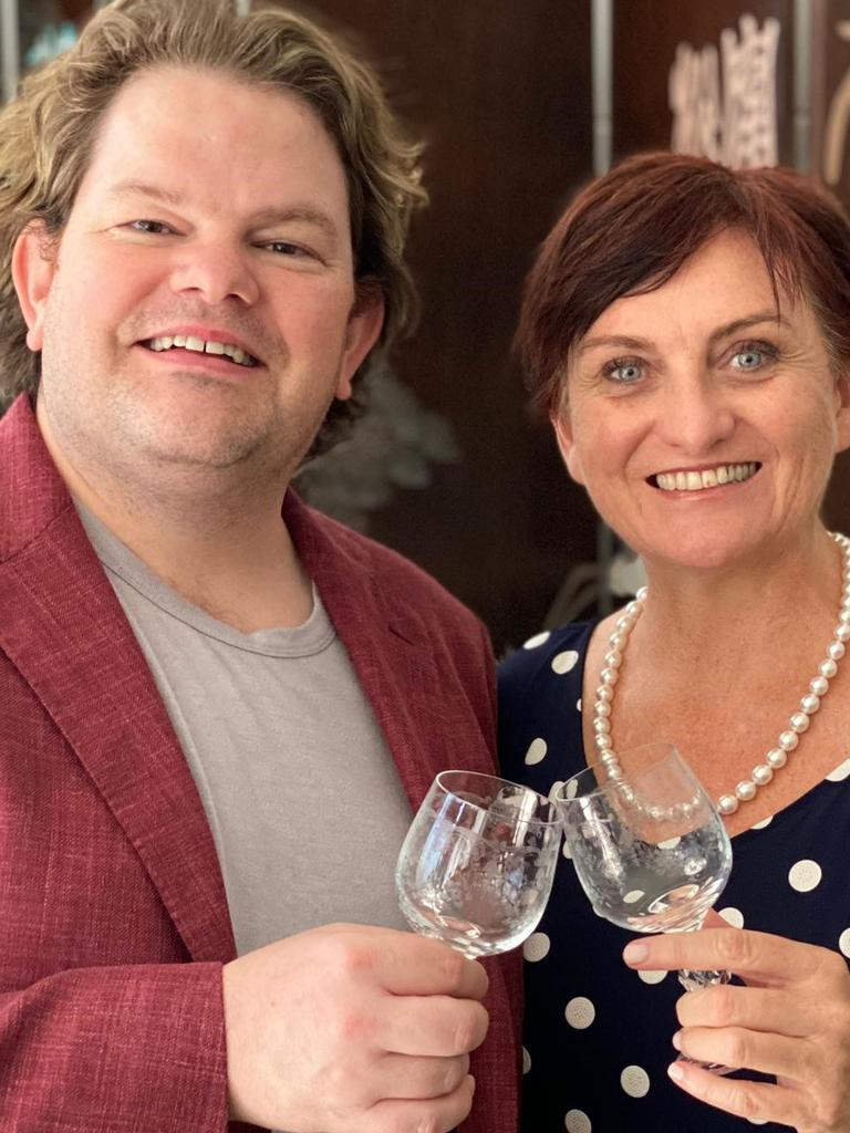 Toasting a bright new opportunity selling old wares in Peregian are business partners Chris Hughes and Simone Milasas.