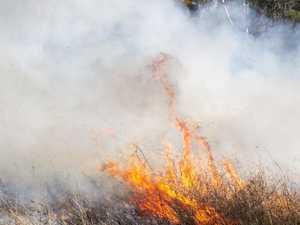 Bruce Highway shut as fireys battle Clairview bushfire