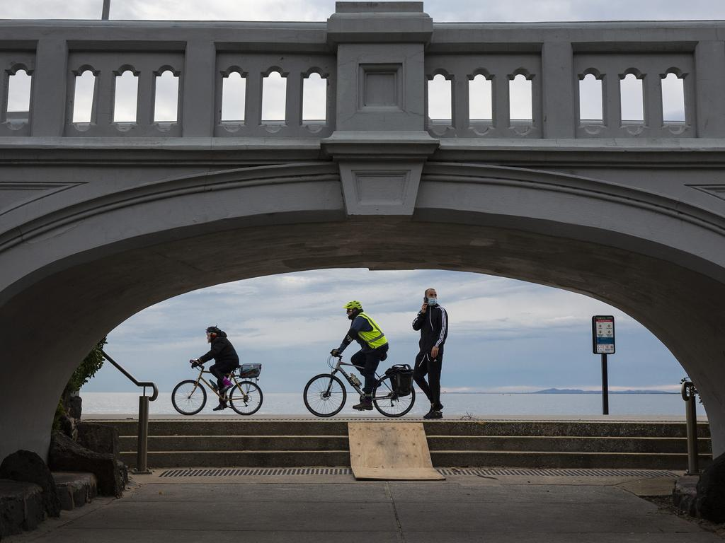 People enjoying their 1 hour of exercise in St Kilda, Victoria. Photo: Daniel Pockett