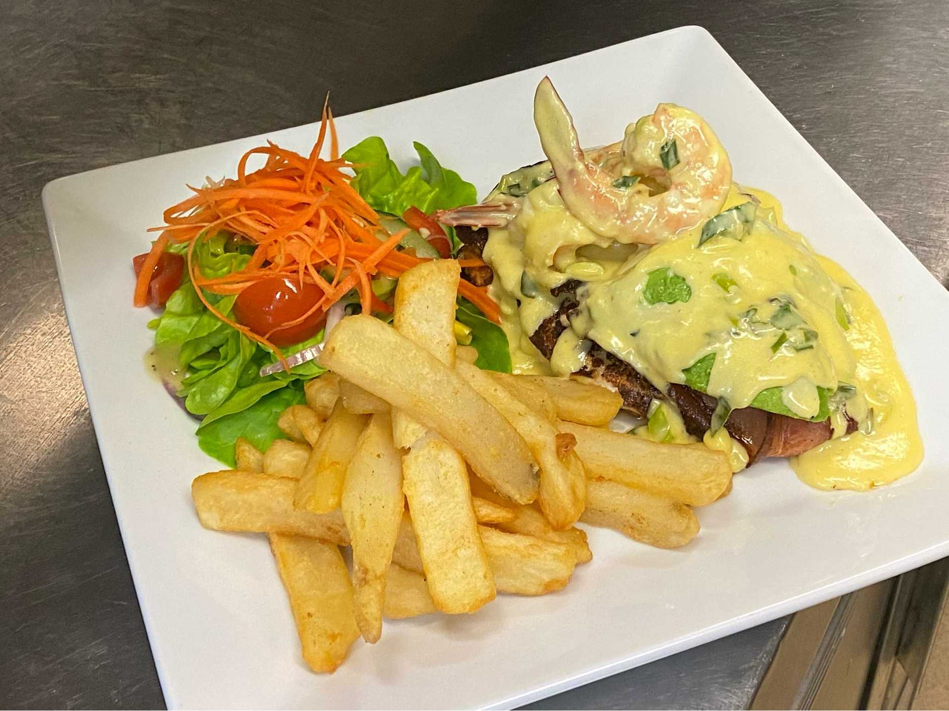 If you're after some pub grub, why not try the chicken bacon prawn and avocado in garlic sauce.