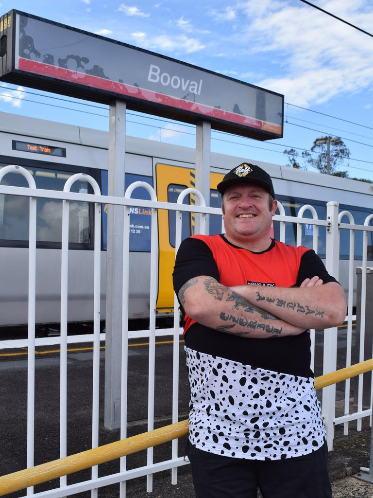 The local known as 'Uncle Sudsy' at Booval train station, where his mural adorns the subway, and near his new tattoo studio.