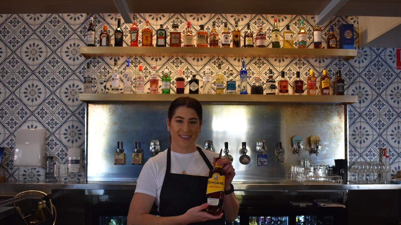 NEW LOOK: Shania Kleidon serving customers at the main bar, at of the Grand Bundaberg Hotel. Picture: Rhylea Millar.