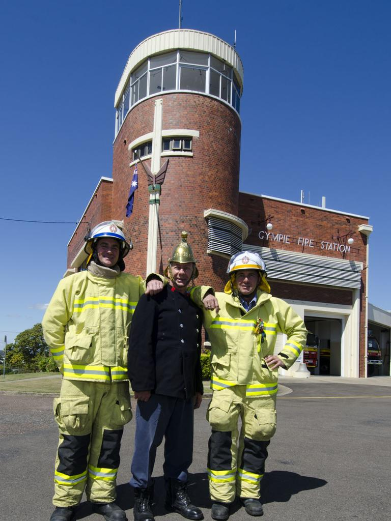 Gympie fire fighters (L-R) John Whiting,Graham Alder (at station since 1963) and Grant Nelson outside the heritage listed fire station. Pic John Wilson