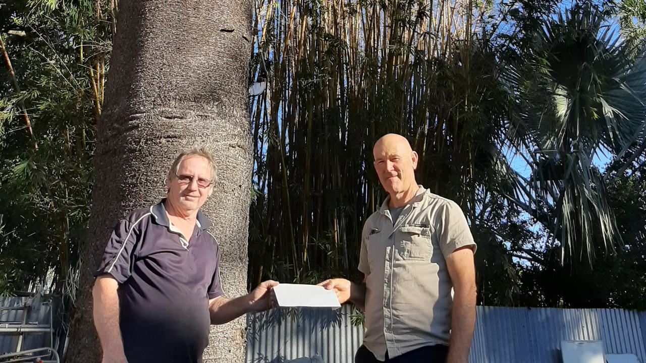 Barry Jensen was awarded a $50 Landcare Nursery voucher from Bundaberg Landcare President Mike Johnson for caring for a Hoop Pine.