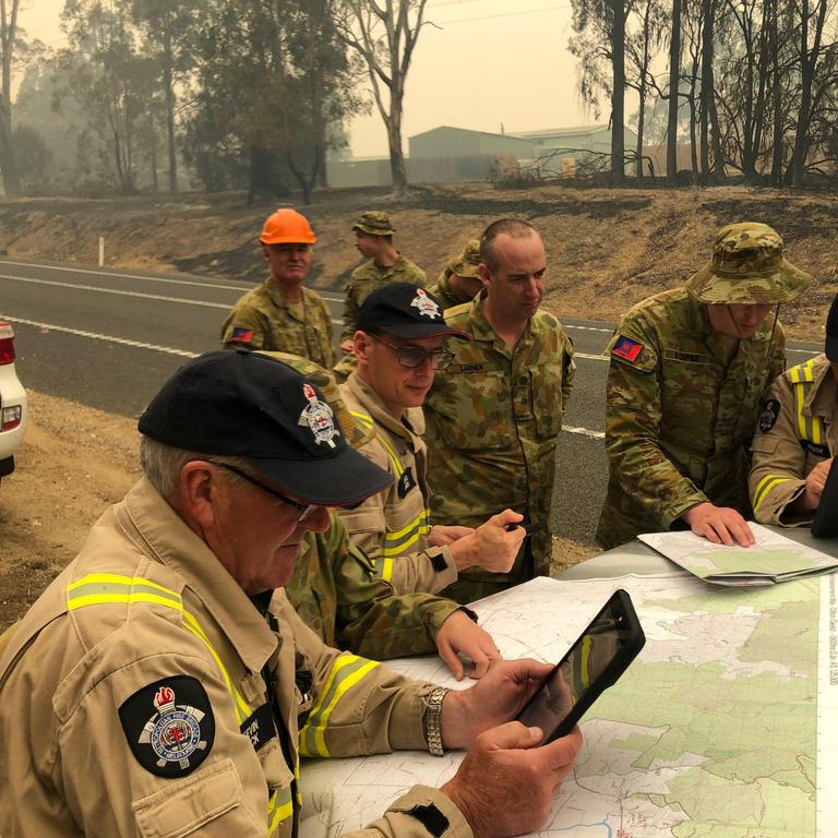 The Melbourne Fire Brigade and Australian Defence Force personnel work together to coordinate Damage Assessments in Sarsfield, East Gippsland.