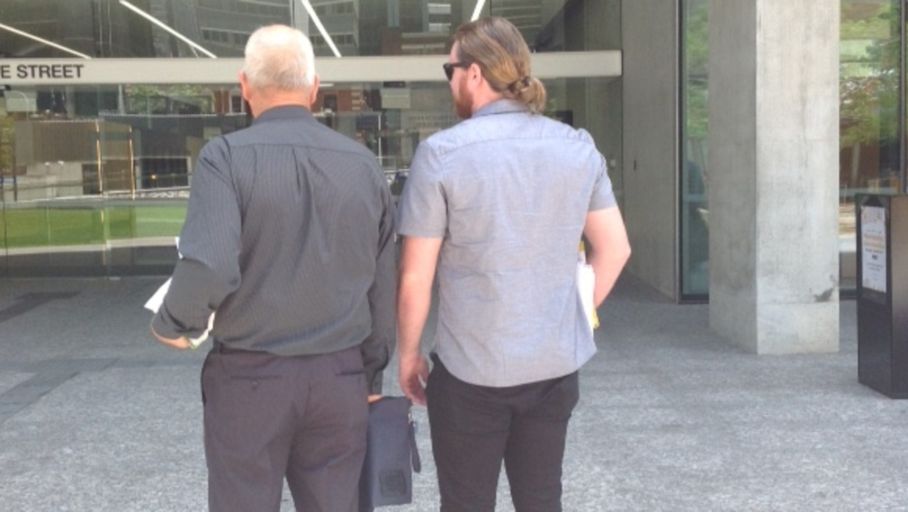 Excavator driver Warren Bruggy, left, and labourer, Daniel Boyd, who found the buried cash. Outside the Supreme Court in Brisbane.