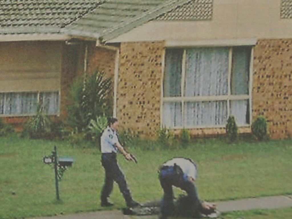 Police keep gun trained on Baladjam during his arrest in Green Valley, southwestern Sydney after he opened fire on them during a counter-terrorism raid. Picture: Supplied