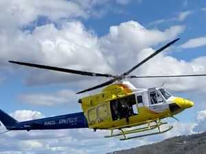 Rescue helicopter attends to injured man after boat fall