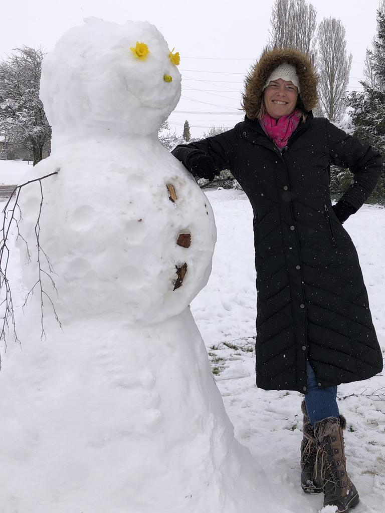 Michelle Carpenter with Oberon's six-foot snowman. Picture Grant Turner