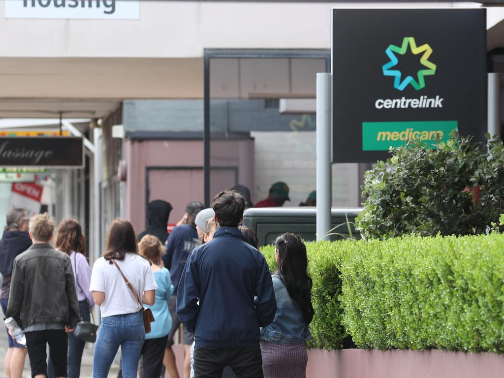 People queue outside a Centrelink. Picture: John Grainger