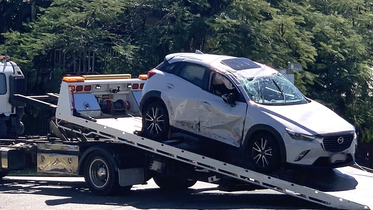 This white Mazda was flipped onto its roof during the two-vehicle crash in North Rockhampton.