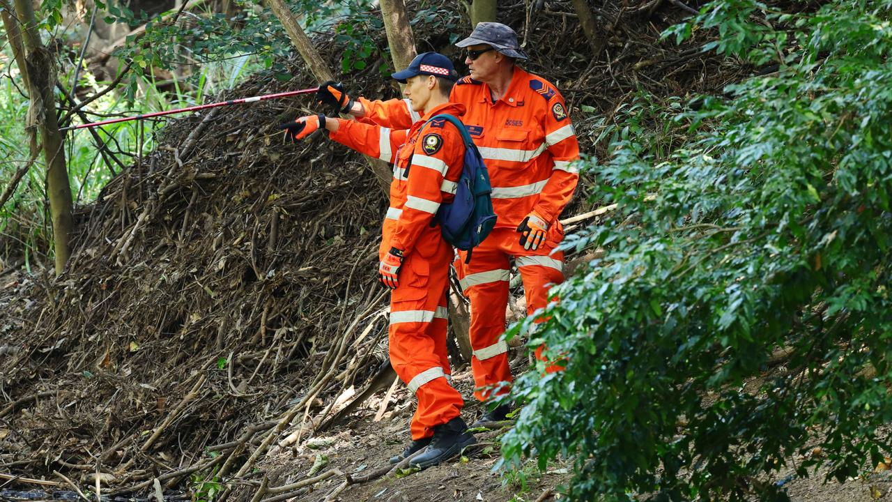 SES volunteers assisted police on a search around the Petrie Creek bridge on Sunday. Photo: Lachie Millard