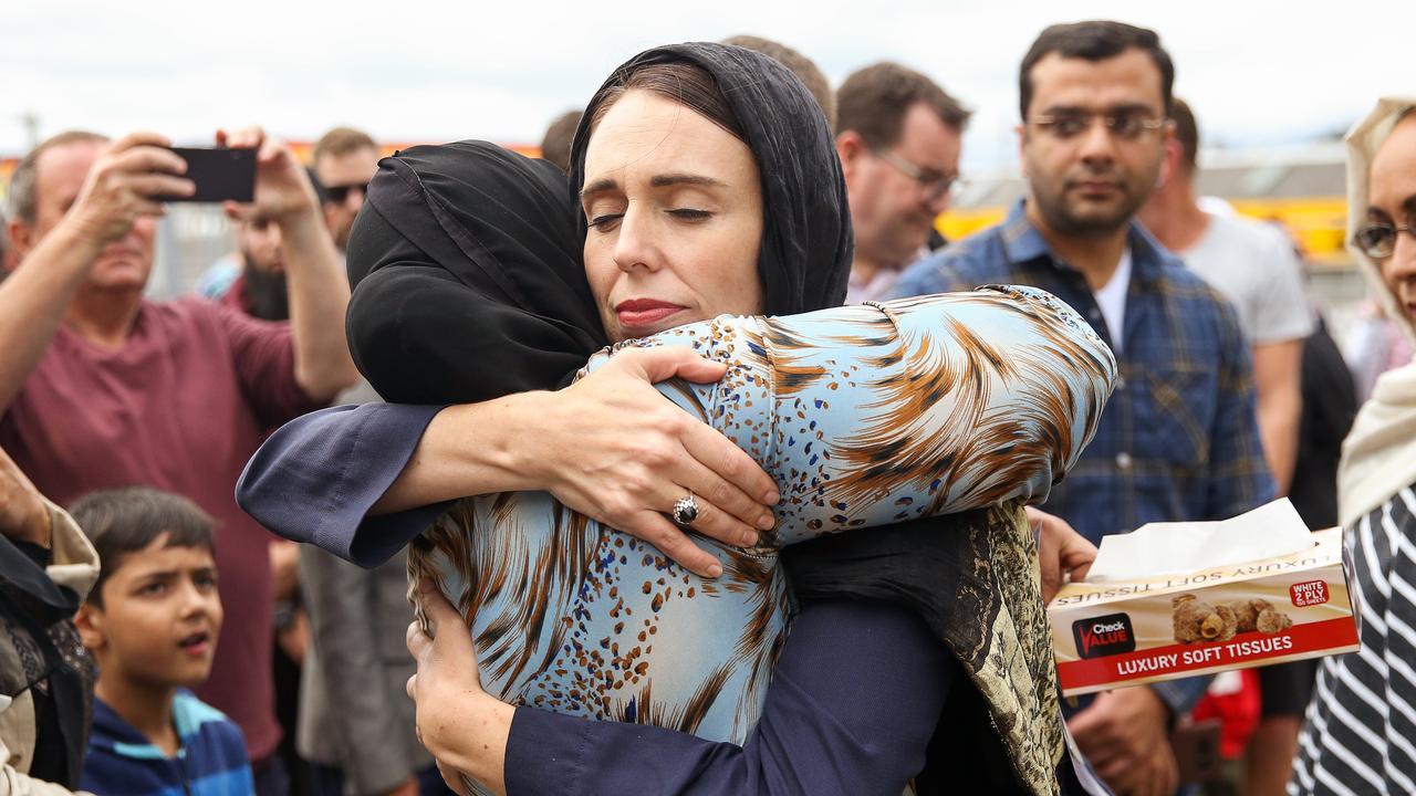 Prime Minister Jacinda Ardern embraces a woman at the Kilbirnie Mosque, Wellington two days after the massacre. Picture: Hagen Hopkins/Getty
