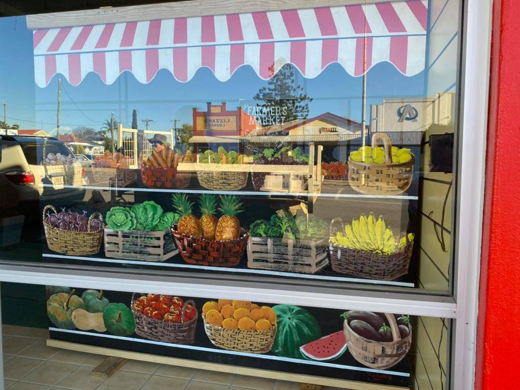 The next stage of Monto's art trail has been completed, in the form of art depictions of old shop fronts. Picture: MMTAG Facebook