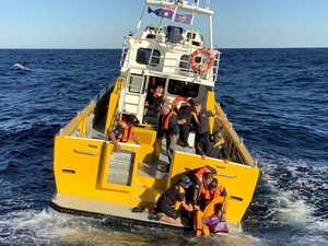 'Extremely lucky': Men found clinging to esky in rough seas