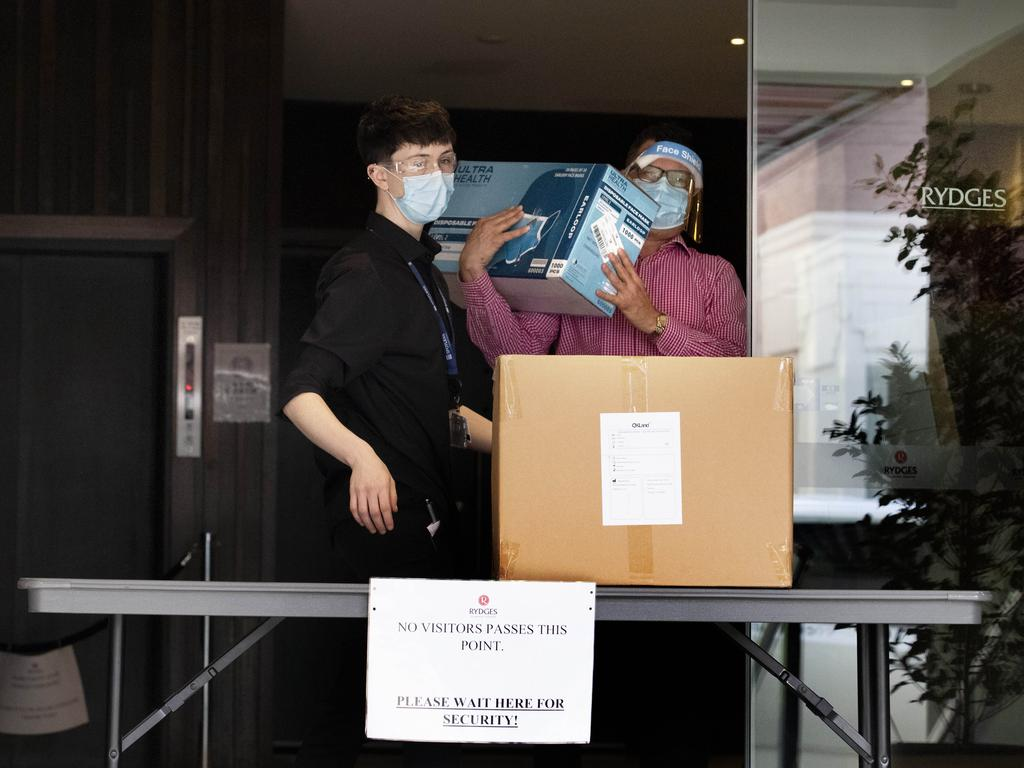 Staff at Rydges receive a delivery of PPE. Picture: NCA NewsWire / David Geraghty