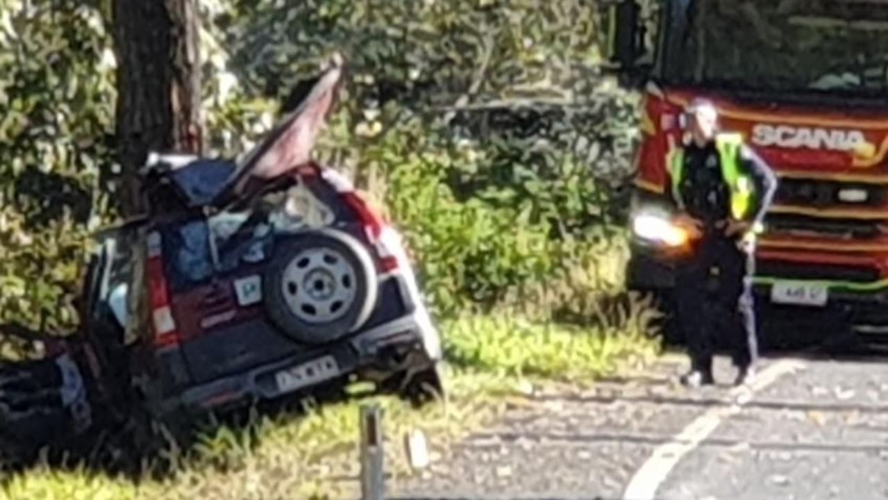 The car which left the Tin Can Bay Road this morning and crashed into a tree, leaving the driver, a man in his 20s, with serious injuries.