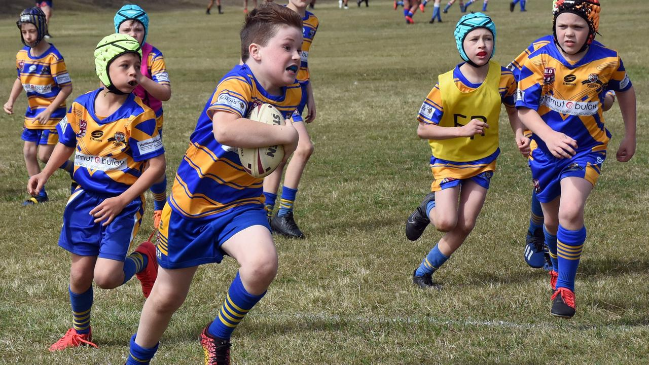 A determined Norths junior runs the ball in his latest under-9 match. Picture: Gary Reid