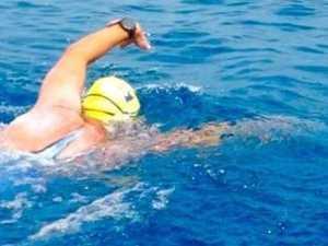 Bay dad fights through pain to finish marathon swim