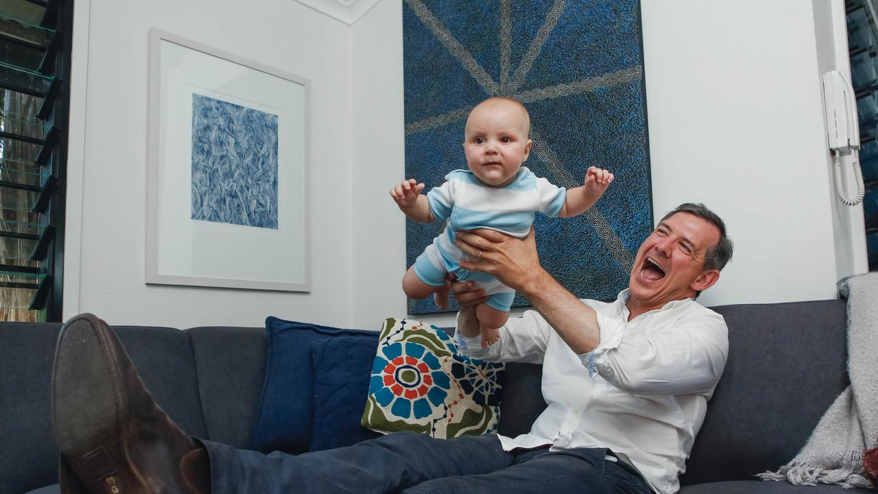 Chief Minister Michael Gunner celebrates with son Hudson, a win in the 2020 election , allowing Labor to govern in its own right. Picture GLENN CAMPBELL
