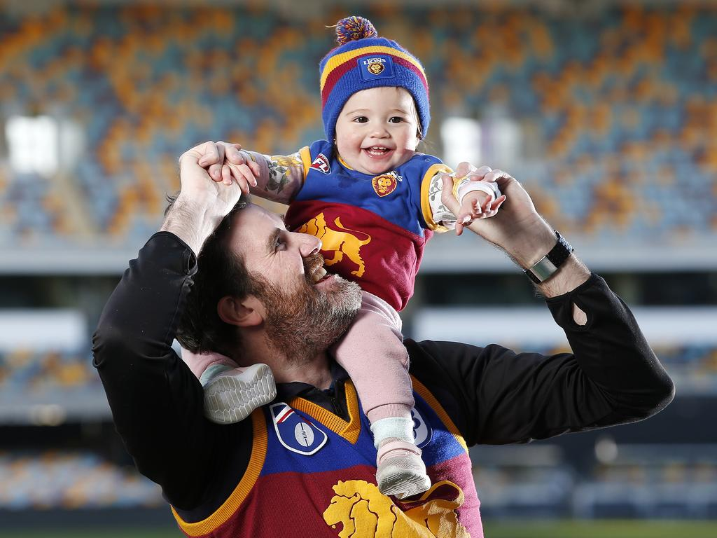 Adam Carlson and Grace Carlson, 1, are Brisbane Lions superfans looking forward to a Gabba grand final. Picture: Josh Woning