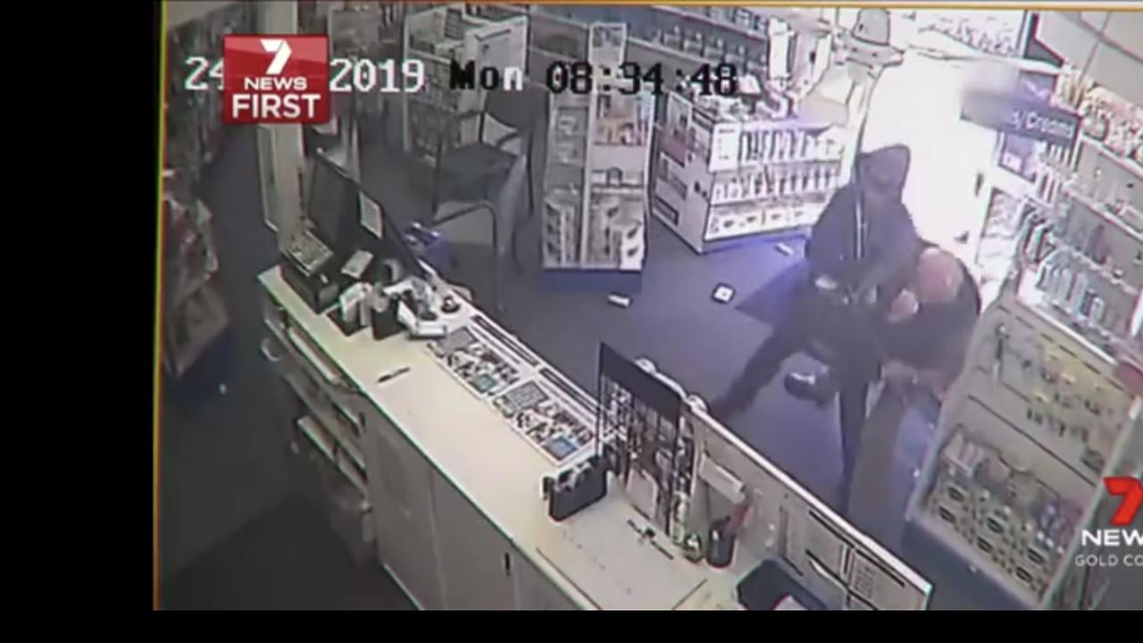 Still from CCTV video of a cleaner bravely confronting raiders at a Nerang pharmacy. Picture: 7News