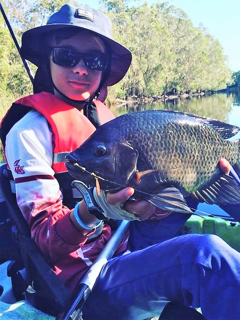 Anglers of all ages are being encourage to record their catches of tilapia in Tweed Waterways as part of a public awareness campaign to monitor the spread of the pest fish. Photo: Conservation Volunteers Australia