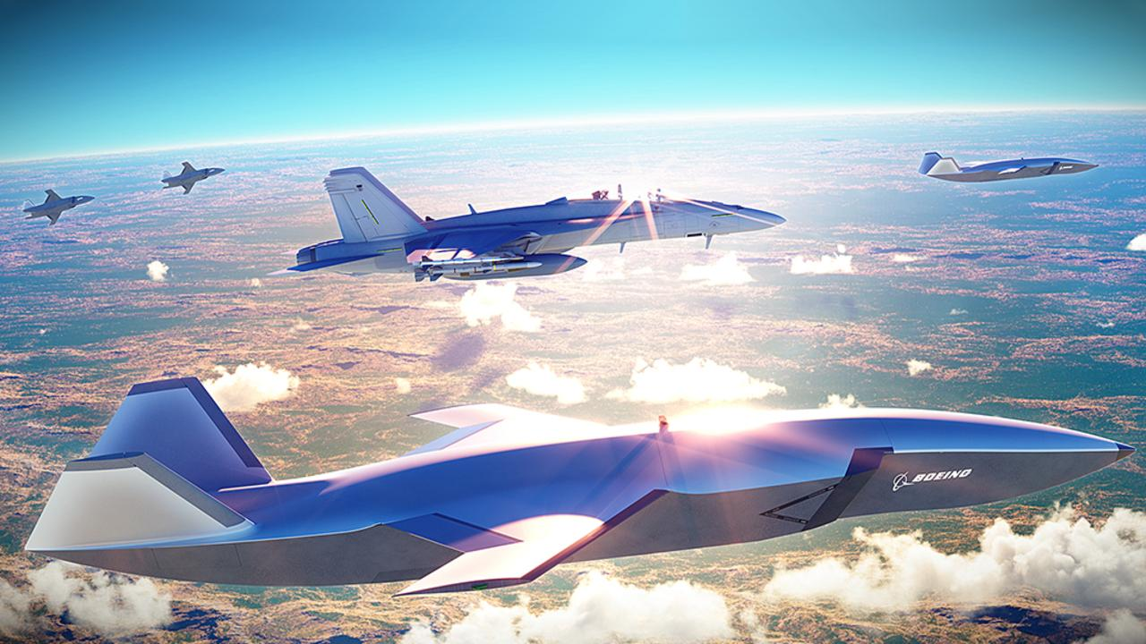 An artist's impression showing the 'Loyal Wingman' drone flying in formation with a manned RAAF F/A-18 fighter. The Loyal Wingman program will be fast-tracked to support 145 jobs. Picture: Boeing
