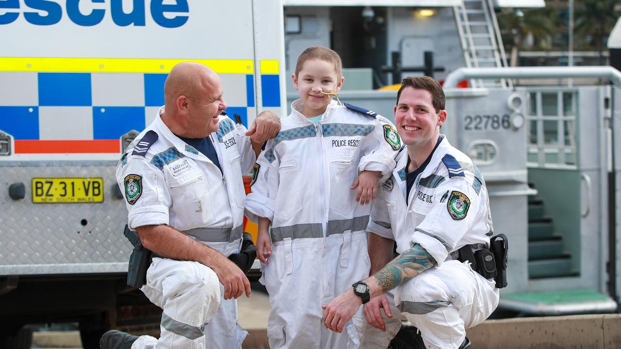 "Mitchell Ray, 6, who is diagnosed with terminal cancer, has spent the day with his heroes, the NSW Police, to ""fight baddies""."