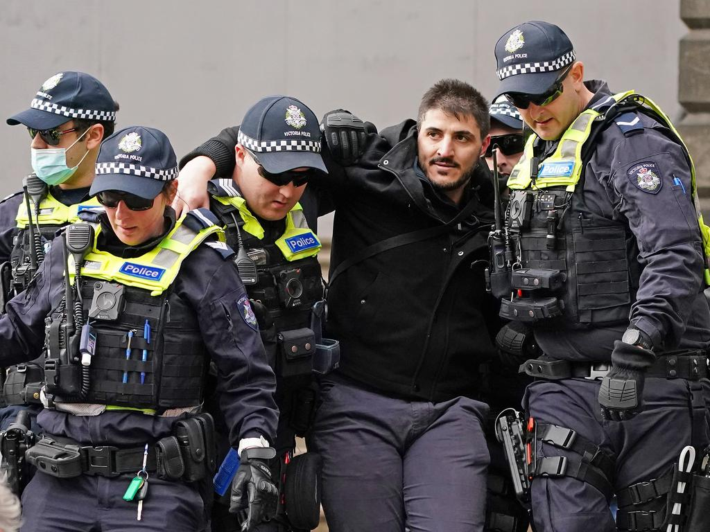 Fanos Panayides is detained by police officers on May 10. Picture: Scott Barbour/AAP