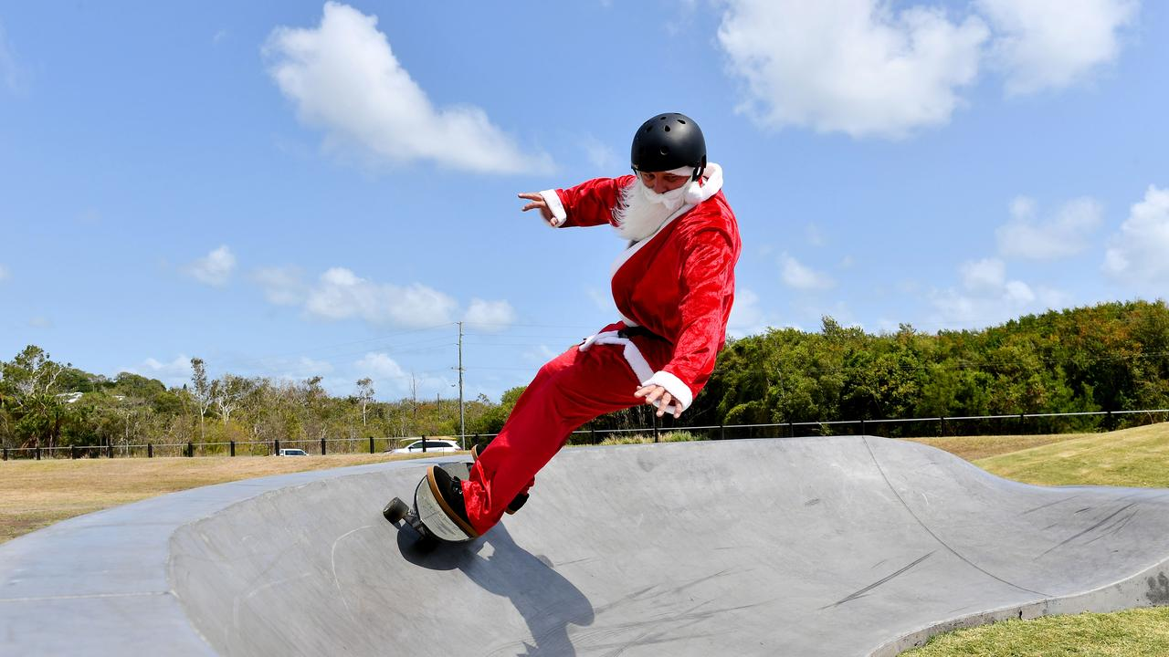 Santa (Ross Gee) has a skate board at the Camilleri Street Skate Park. Picture: Tony Martin