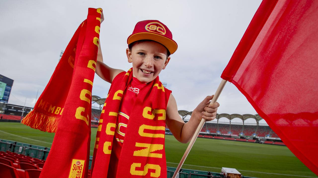 Suns fan Finn Reynolds, 10, at Metricon Stadium. Picture: Jerad Williams.