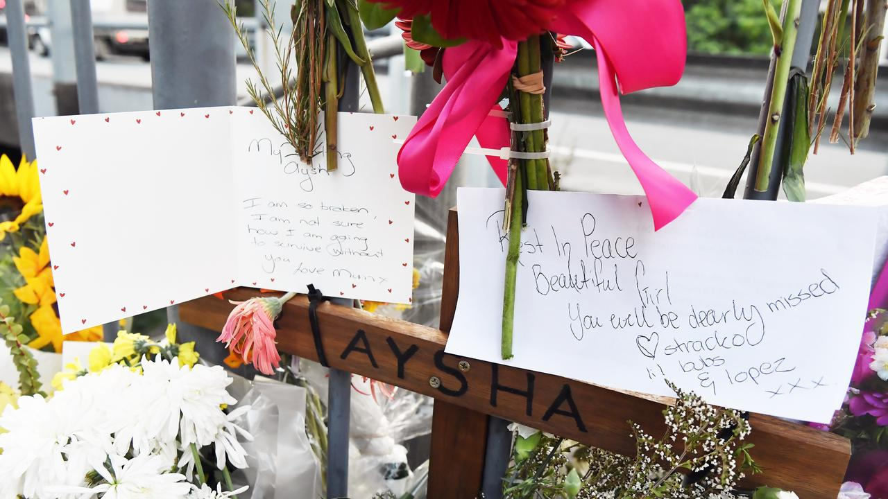 Floral tributes at Petrie Creek Bridge. Photo: Patrick Woods