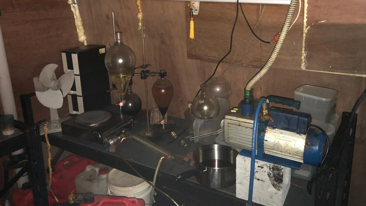 Police discovered an alleged drug lab and underground bunker in a Banora Point home. Photo: NSW Police