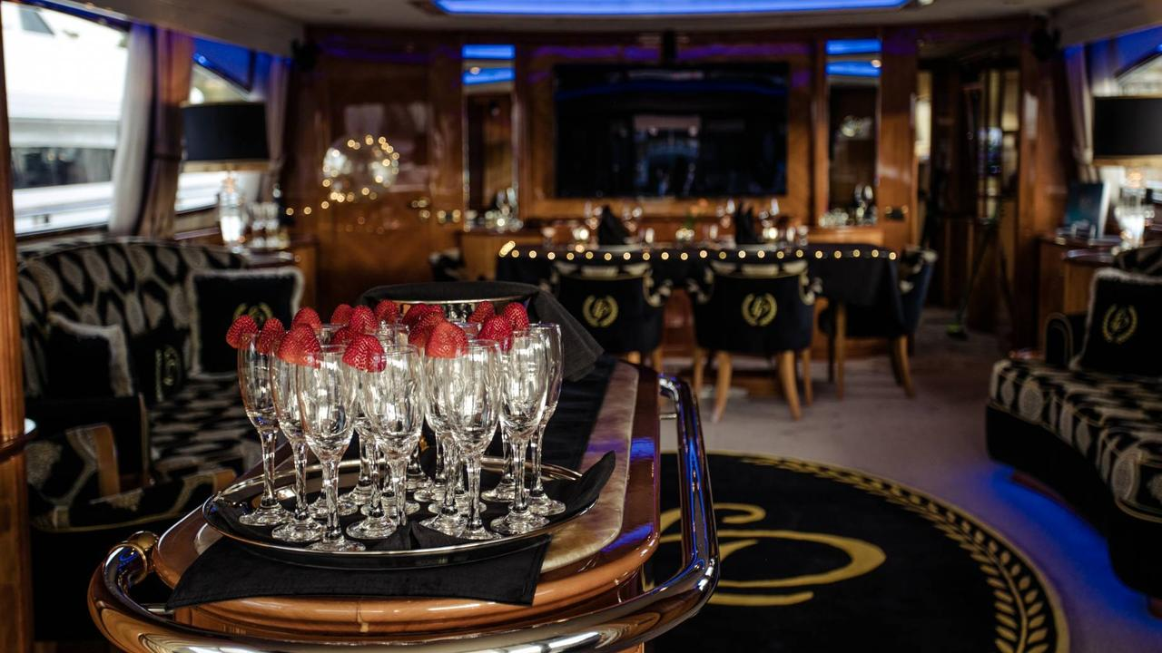 Drinks in the VIP stateroom which seats eight for dinner from a lavish menu.