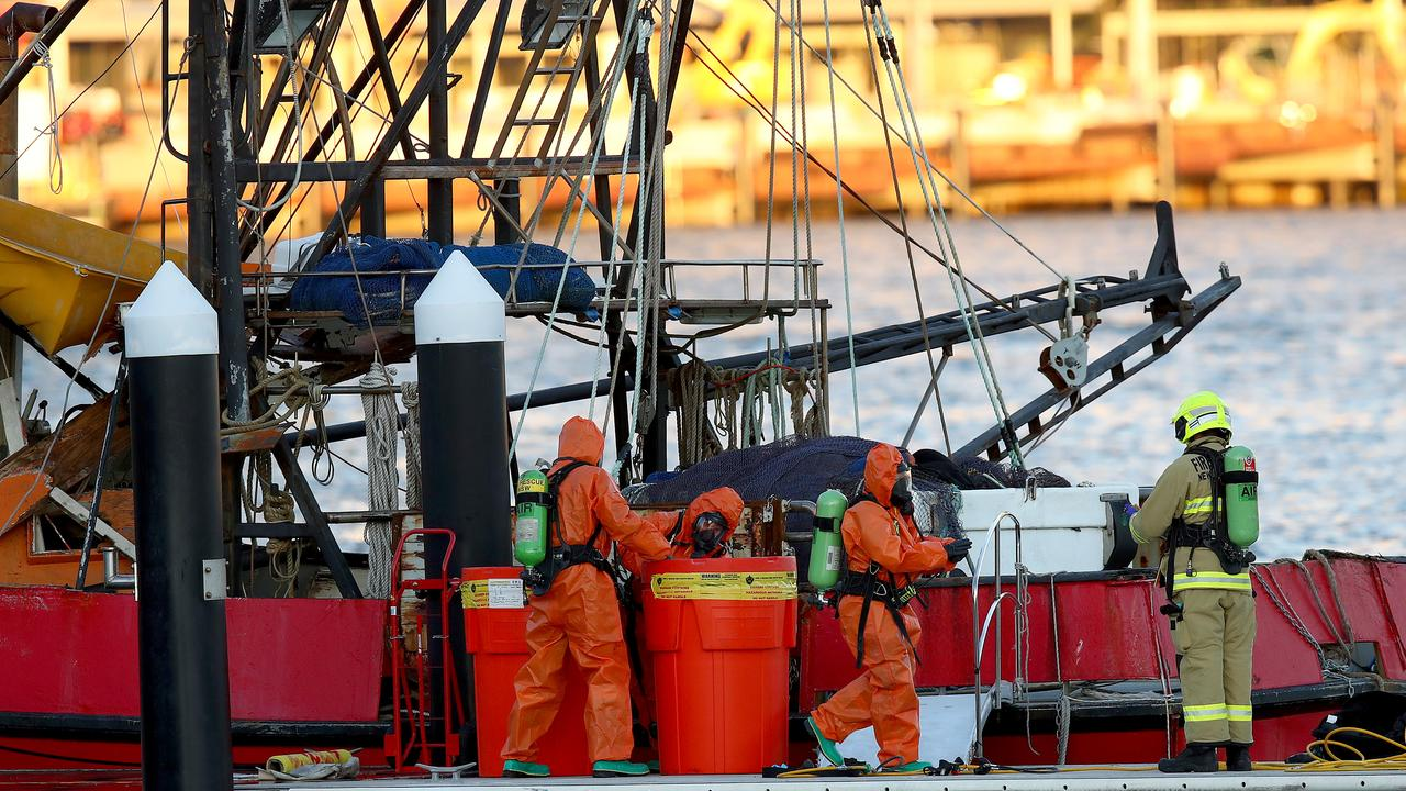 Police and Fire and Rescue NSW personnel search the fishing trawler for drugs after those on board the vessel were arrested. Picture: Toby Zerna