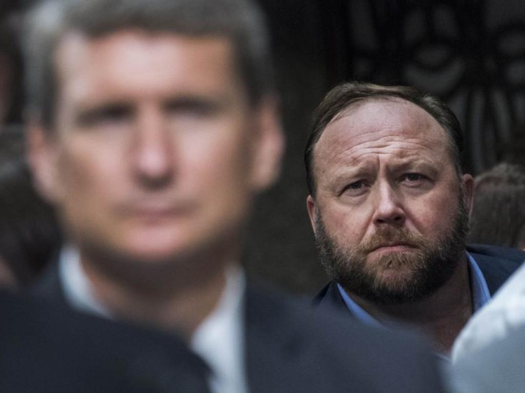 Alex Jones of Infowars at a Senate hearing that featured Jack Dorsey, left, the CEO of Twitter, and Sheryl Sandberg, a top Facebook executive. Picture: Tom Williams/Congressional Quarterly/Zuma Press