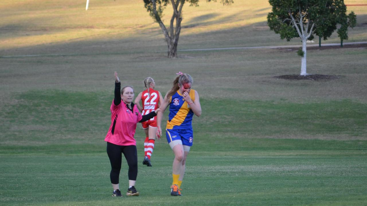 Ipswich Eagles captain Rebecca Mccarthy was escorted off the field after a nasty head clash that required 17 stitches