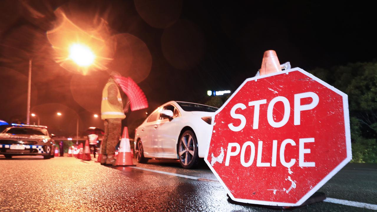 1am August 8 2020, Gold Coast Highway Coolanagatta Queensland – Queensland Police Officers with the assistance of The Australian Army stop all traffic into Queensland for checks at 1am on QLD/NSW border crossing due to increased lockdown of the State of Queensland Scott Powick Newscorp