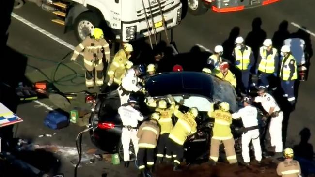 A woman is dead, two men have head injuries and a second woman is trapped in her car (pictured) after a horror crash on the Sydney Harbour Bridge Picture: 9 News Source:Supplied