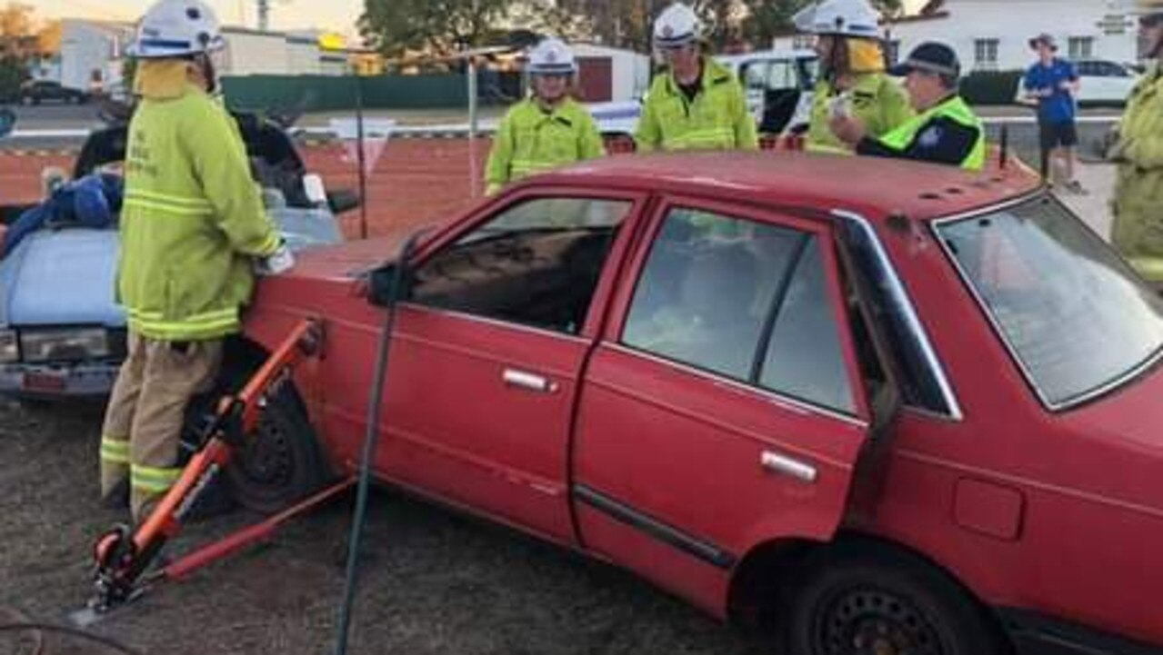 Emergency Service Workers provide an example of what is involved in a traffic incident. Photos: Queensland Police