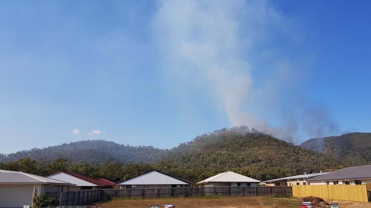BUSHFIRE SEASON: Norman Garden resident Mark Spencer's photo showed smoke passing over nearby mountaintops yesterday.