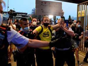 Fans storm Barca gates as Messi flees