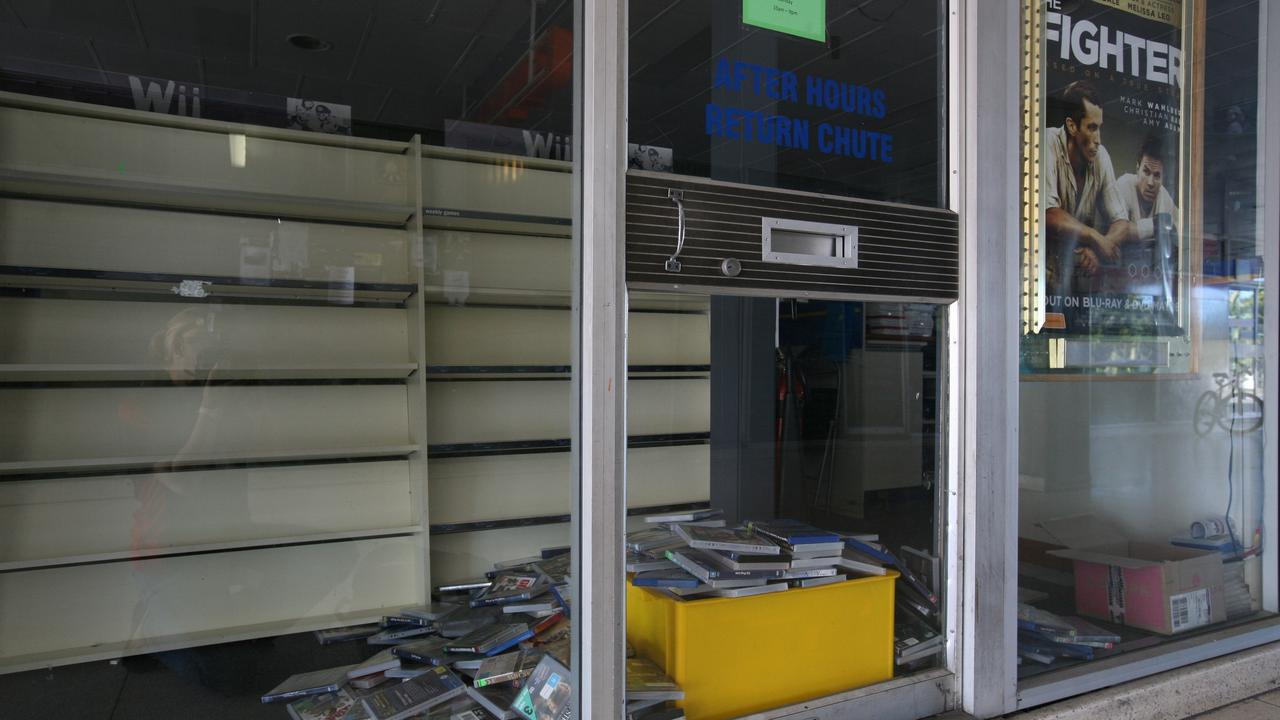 Returned DVDs piled up at Blockbuster Video at the 4-ways after the business closed. Picture: Lee Constable.