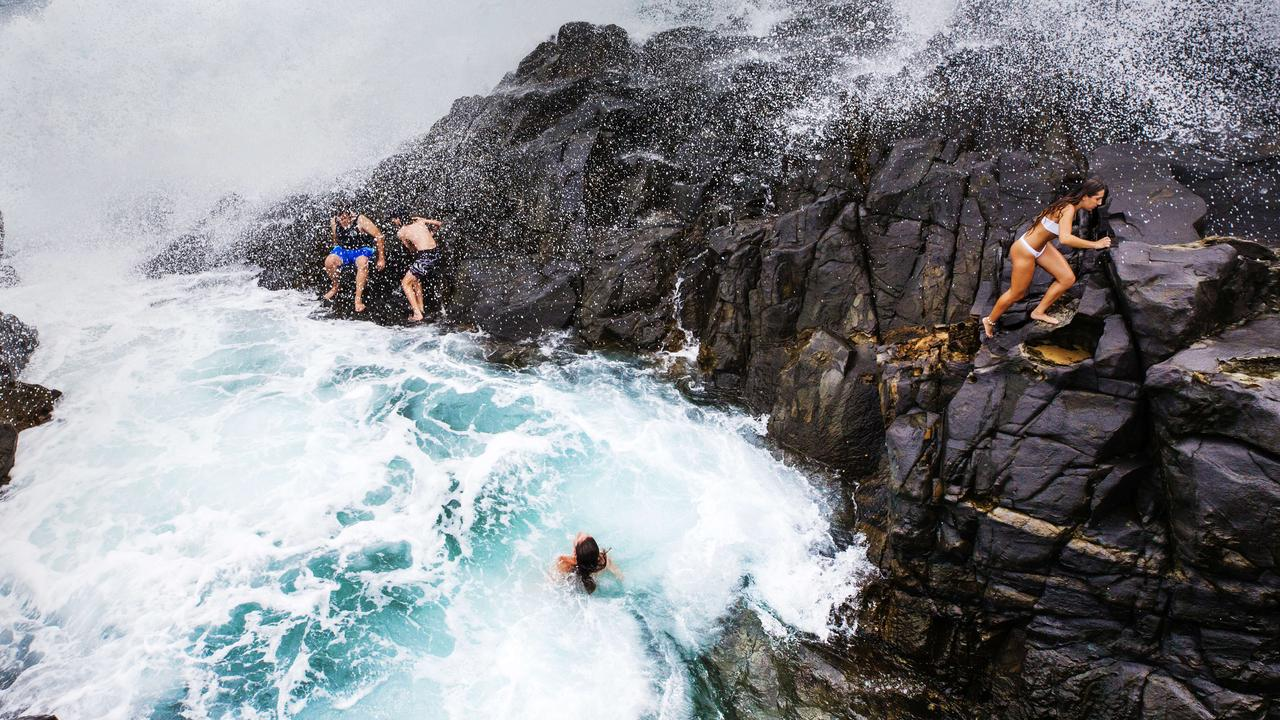 A Noosa Heads Surf Life Saving patrol group has been recognised for a monumental day of rescues in January which included three at Noosa Fairy Pools. Photo Lachie Millard