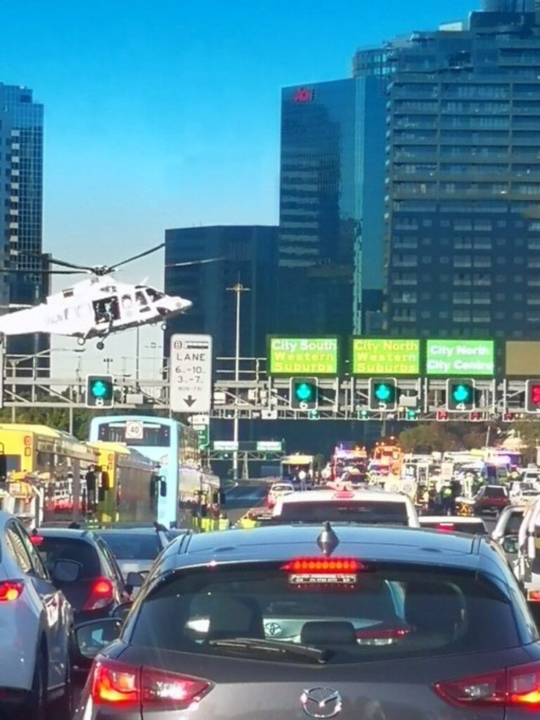 A rescue helicopter approaches the harbour bridge after the crash. Picture: Supplied