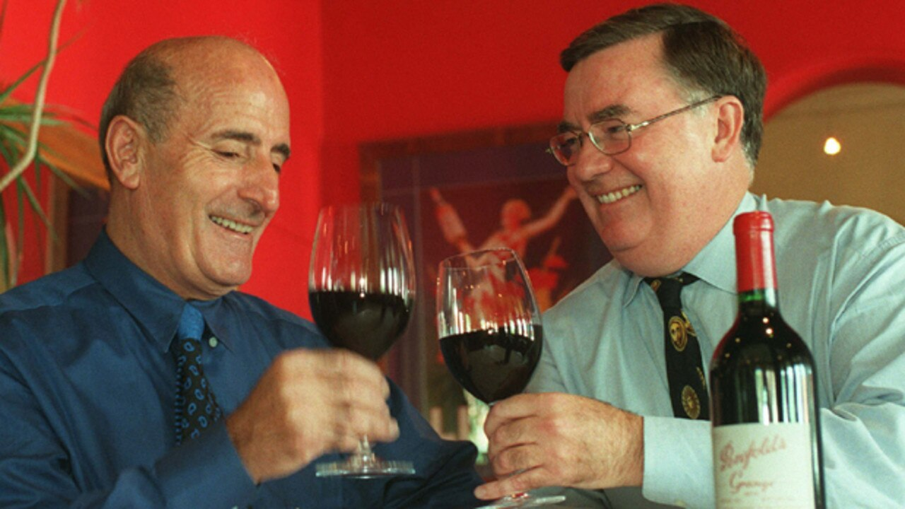 Grape hotel and bottle shop chain merger. Theo Karedis of Theo's Liquor Market Group (L) and Grape Management Group chairman Clive Kitchen celebrate their partnership (pictured in 1999).