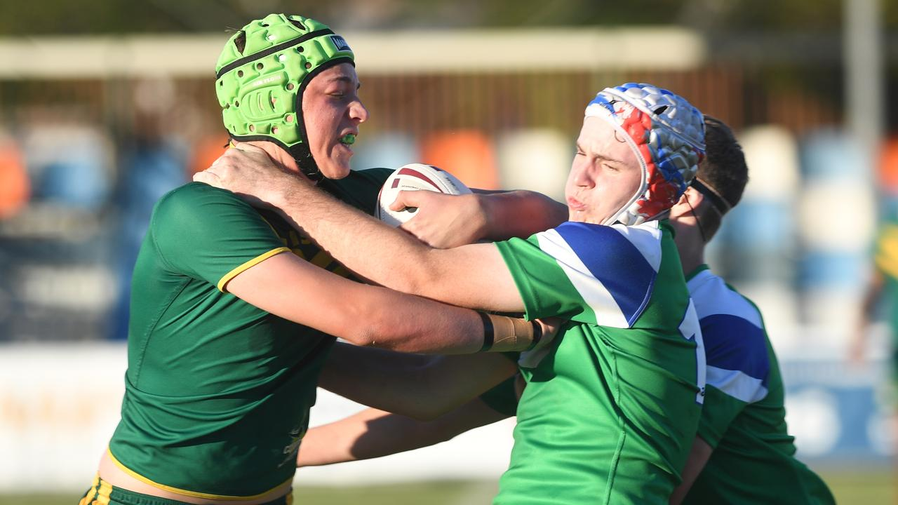St Brendan's Mitch Baker runs into the TCC defence in the Cowboys Challenge game at Browne Park. Photo: Jann Houley