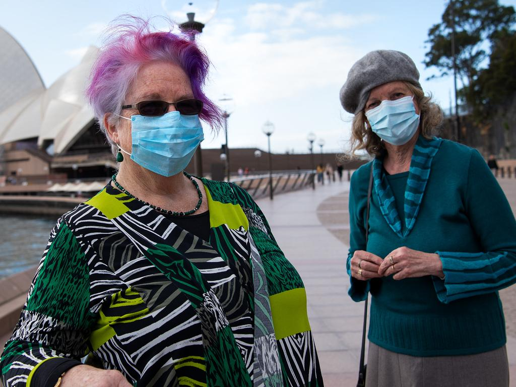 Anita Brown and Jen Charteris wear face masks and adhere to social distancing measures to prevent the spread of COVID-19 in Sydney. Picture: Bianca De Marchi